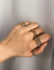 Fashion Gold Engraved Knotted Winding Hollow Diamond Set Ring